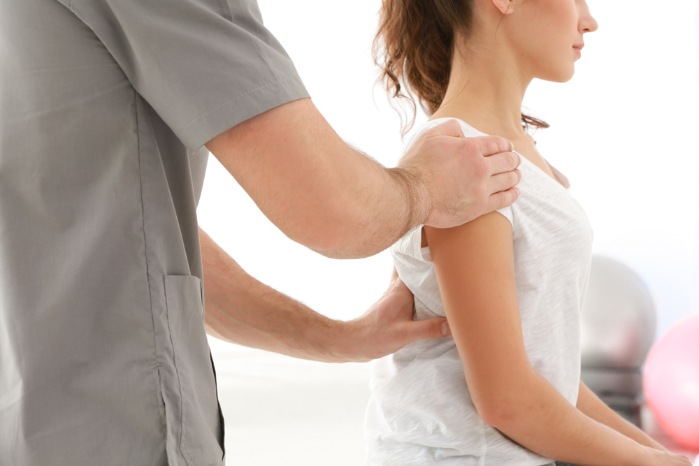 Chiropractor treating patient for back pain