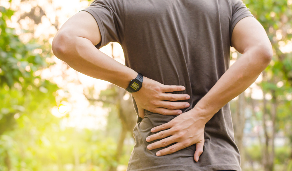 Man with back pain needs a chiropractic exam.
