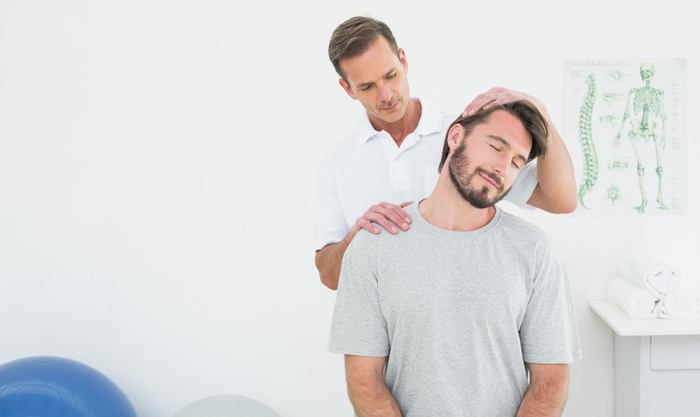 Man receiving neck pain treatment from his chiropractor.
