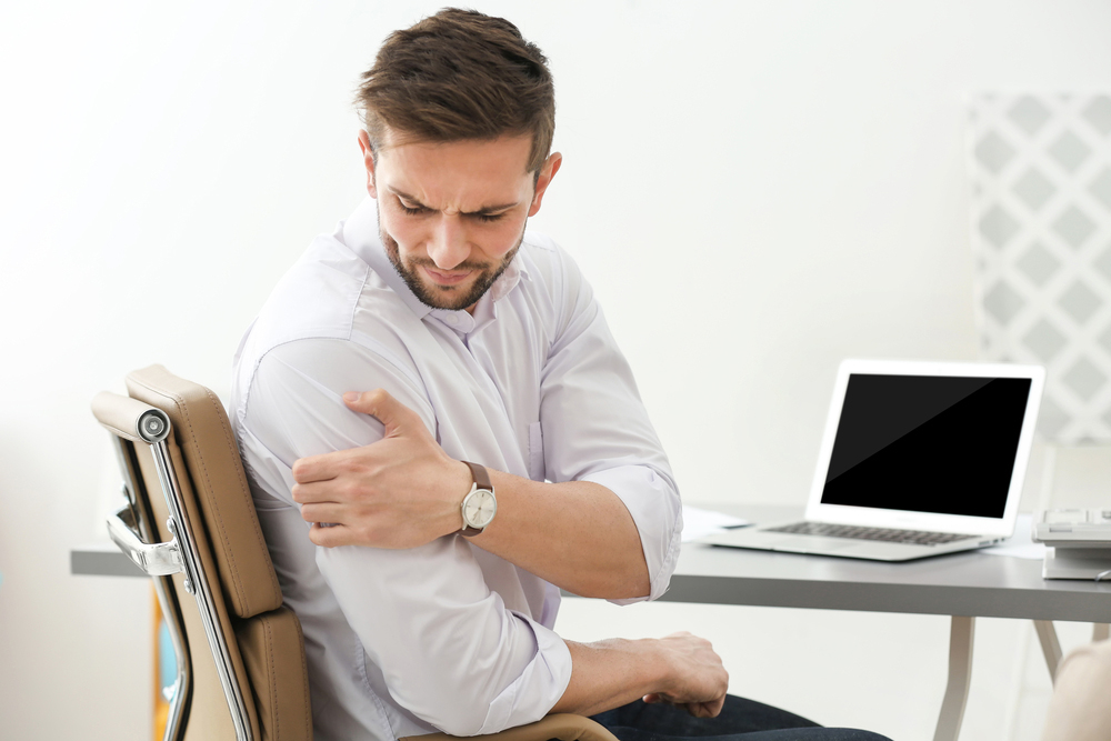 Man with shoulder pain needs chiropractic care in Sarasota. FL.